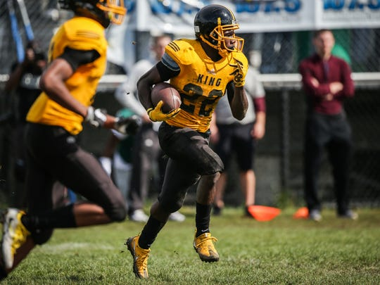 Detroit King's Jae'Veyon Morton runs the ball against