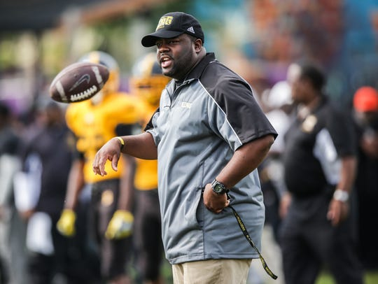 Detroit King head coach Tyrone Spencer watches his