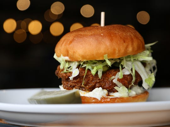 """The """"Nashville hot chicken"""" sandwich from the Morrie in Royal Oak is gently spiced and mellowed by a garlic aioli with bleu cheese, lettuce and pickles."""
