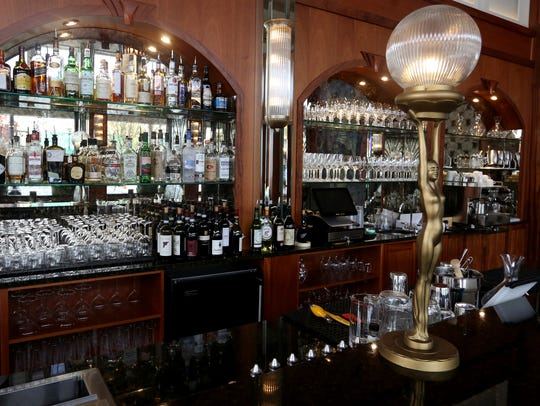 The bar with modern art deco lighting fixtures at Paradiso