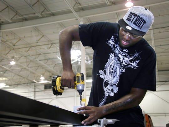 Raymond Pierce of Detroit, 20, works as an assembler