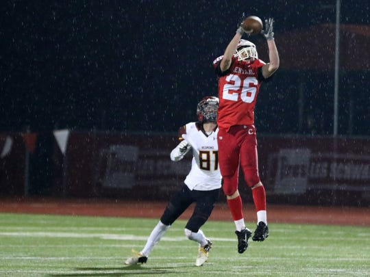 Central's Peter Mason (26) makes an interception from Redmond's Brady Daniels (81) in the second half of the Redmond vs. Central OSAA Class 5A quarterfinal football game at Central High School in Independence on Friday, Nov. 11, 2016. Central won the game 42-36.