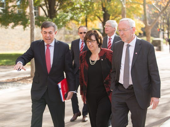Incoming Cornell University President Martha E. Pollack (center) walks with Board of Trustees Chair Robert Harrison