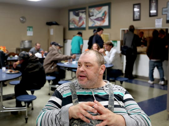 Ron Cutsforth sits in the dining room as lunch is served at the Union Gospel Mission in downtown Salem on Wednesday, Nov. 16, 2016.