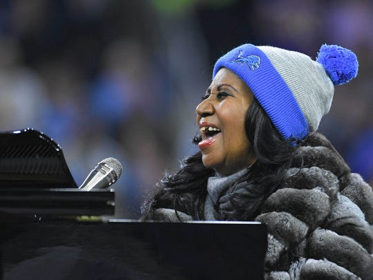Nov 24, 2016; Detroit, MI, USA; Recording artist Aretha Franklin performs the national anthem before the game between the Lions and the Vikings on Thanksgiving at Ford Field.