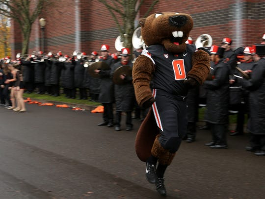 The Beaver mascot performs as tailgaters watch before
