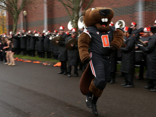 The Beaver mascot performs as tailgaters watch before the Oregon vs. Oregon State Civil War football game at Oregon State University in Corvallis on Saturday, Nov. 26, 2016.