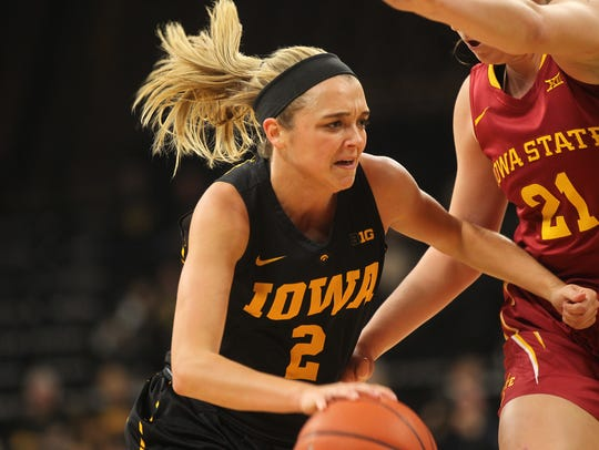 Iowa's Ally Disterhoft drives to the hoop during the