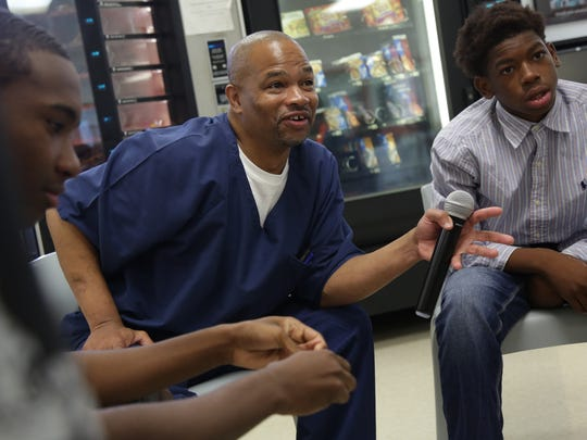 Darryl Woods, 44 who has been locked up for 26 years after being sentenced to life in prison for first-degree murder, leads a group session where teens attending the Youth Deterrent Program can share their story and get advice.