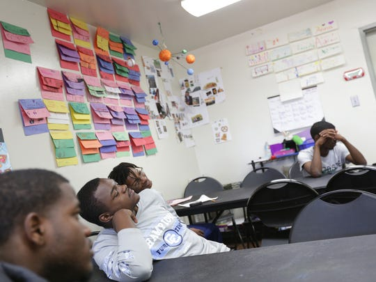 Fellows from the Office of Neighborhood Safety program in Richmond, CA talk with their mentors during a life skills class on July 12, 2016. The ONS program tries to identify some of the men more likely to kill before they pull the trigger and convince them to sign up for an 18-month fellowship, getting them mentors, promising daily visits from positive role models, while giving them guidance and life skills.