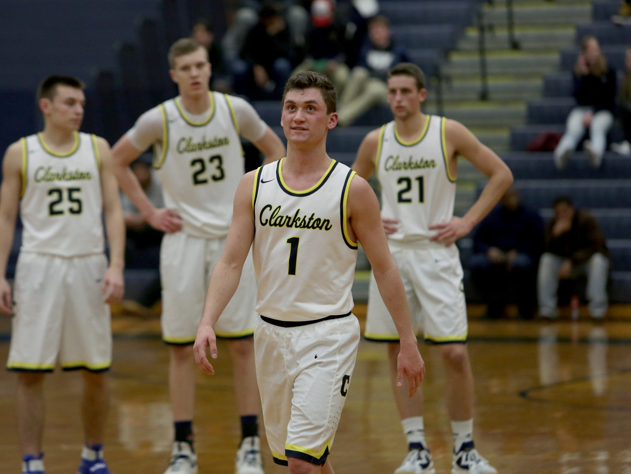 Clarkston point guard Foster Loyer (1) looks at the scoreboard during a game against Hazel Park on Thursday, Jan. 12, 2017, at Clarkston.