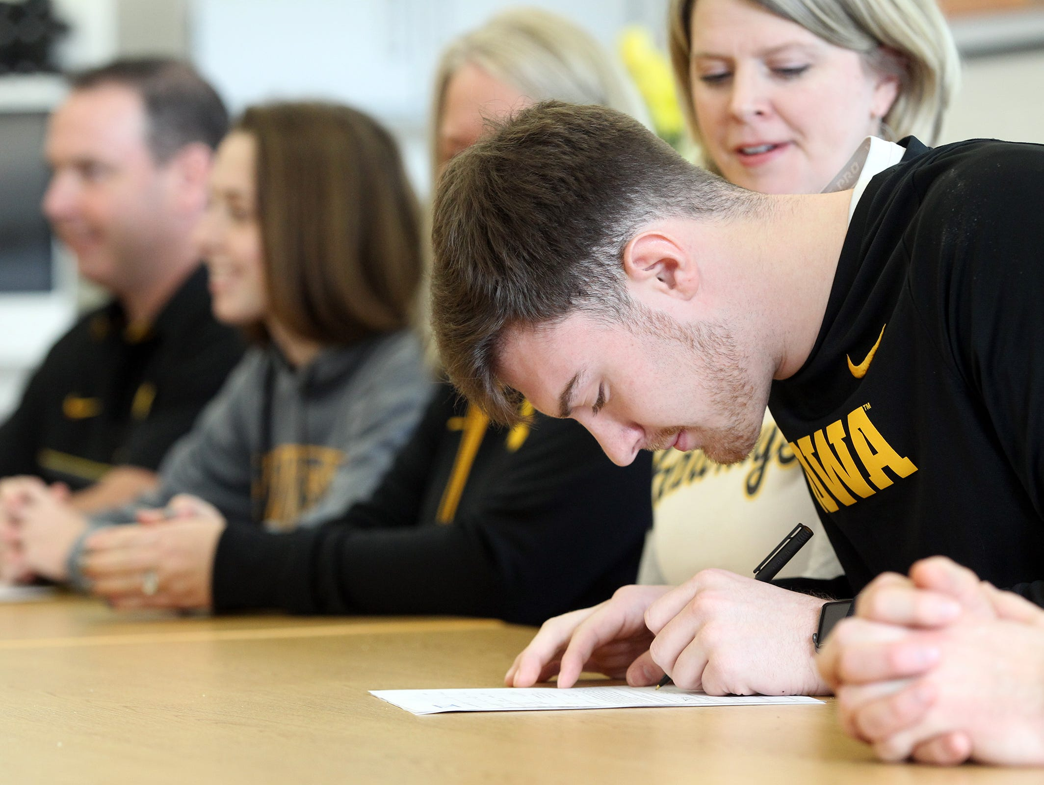 Solon senior Jake Coons signs his letter of intent to play football at Iowa on Wednesday, Feb. 1, 2017.