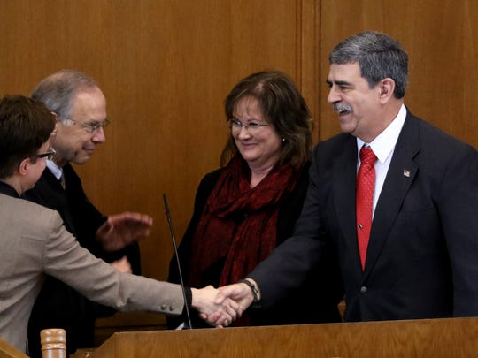 Silverton Mayor Rick Lewis, far right, shakes hands with Rep. Tina Kotek after being sworn in as House District 18 Representative during a House of Representatives floor session at the Oregon State Capitol in Salem on Thursday, Feb. 23, 2017. Vic Gilliam resigned from the seat before the start of the legislative session this year due to his diagnosis of ALS.
