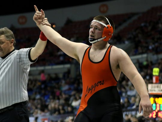 Scio's Ryan Mask is named the winner in the OSAA Wrestling State Championships Class 3A quarterfinals for weight 220 at the Memorial Coliseum in Portland on Friday, Feb. 24, 2017.
