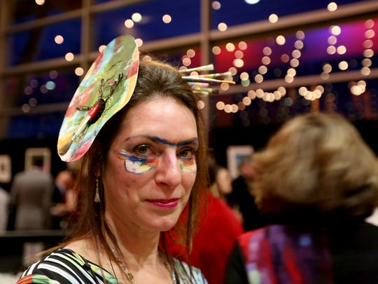 "Denise Magee, the development coordinator with the Salem Art Association, wears a paint palette in her hair during the 18th annual Clay Ball at the Salem Convention Center on Saturday, Feb. 25, 2017. The theme for this year's auction and dinner supporting the SAA was ""Masterpieces"". Guests were encouraged to dress as their favorite artist or work of art."