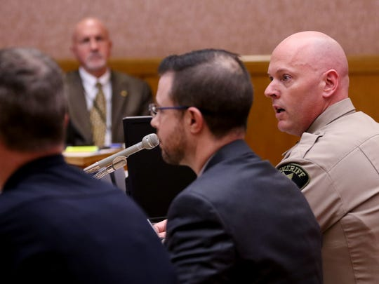Todd Moquin, a sergeant with the Marion County Sheriff's Office, testifies during a House Judiciary Committee hearing on House Bill 2957, which would broaden the definition of illegal mobile electronic devices used while driving, at the Oregon State Capitol on Tuesday, Feb. 27, 2017.
