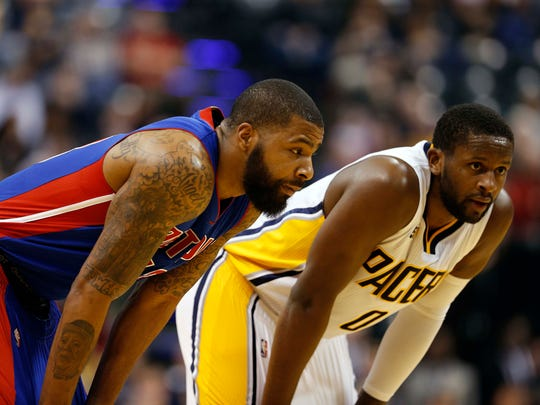 Pistons forward Marcus Morris and Pacers guard C.J.