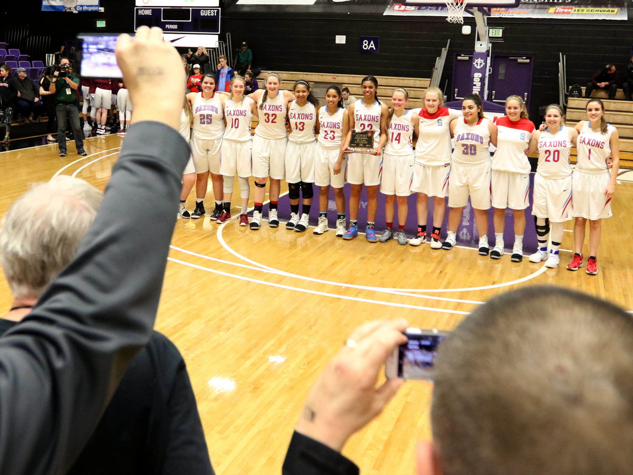 South Salem stands with their trophy following the Grant vs. South Salem girl's basketball game to determine third place in the OSAA Class 6A State Championships at the University of Portland on Saturday, March 11, 2017. South Salem won the game 58-53.