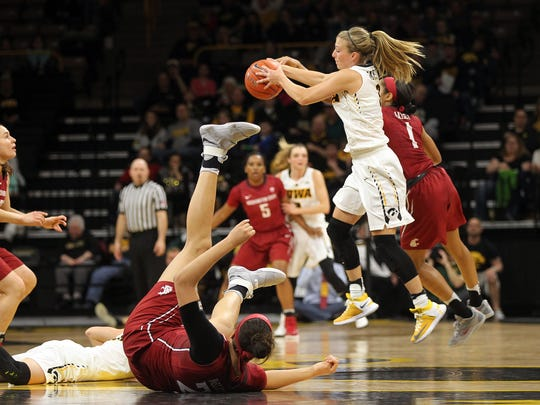 Iowa's Makenzie Meyer grabs a loose ball during the Hawkeyes' WNIT Elite Eight game against Washington State at Carver-Hawkeyes Arena on Sunday, March 26, 2017.