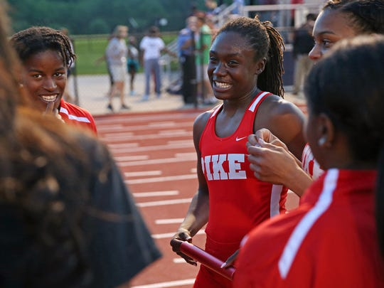 Pike's Lynna Irby smiles after the IHSAA girls track