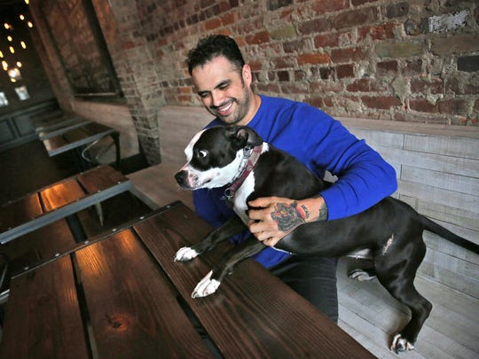 Joshua Gonzales hangs out in his Fountain Square bar,