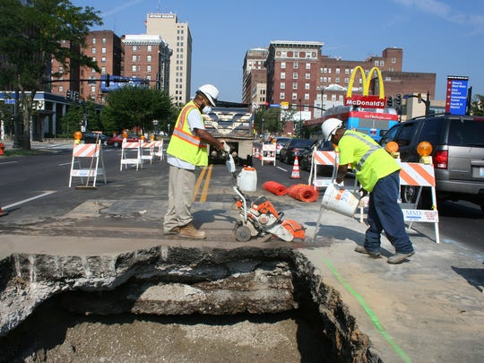 An MSD crew wraps up fixes to a sewer collapse that has slowed traffic on East Broadway this week. An MSD crew wraps up fixes to a sewer collapse that's slowed traffic on East Broadway.