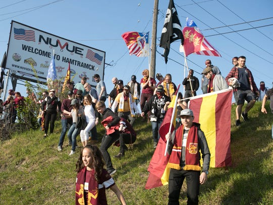 Detroit City FC fans walk to the game against Milwaukee Torrent on Friday, May 12, 2017 at Keyworth Stadium in Hamtramck.