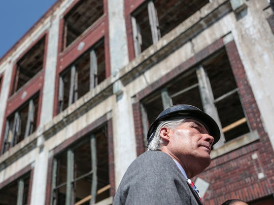 Packard Plant owner Fernando Palazuelo talks with the