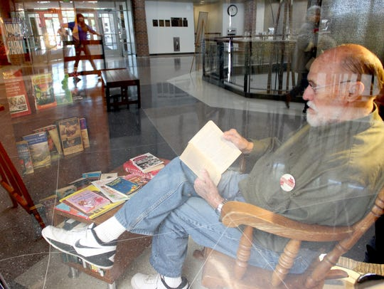 Former Coralville Mayor Jim Fausett reads J.K Rowling's