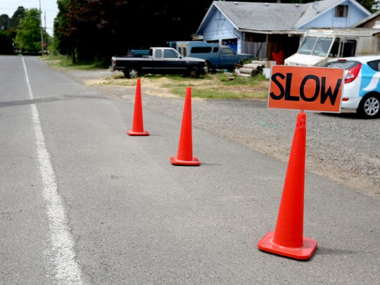 Traffic cones urge drivers to move slowly on a road near Scott Elementary School in Salem on Wednesday, June 7, 2017. After school let out on Monday a student walking on the road without sidewalks and was hit by a pick-up truck.
