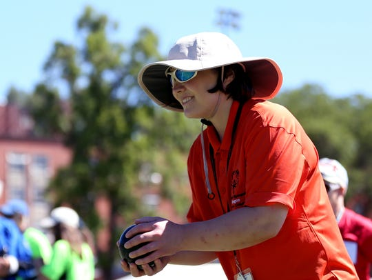 Jenny Hill, 30, of Salem, tosses a ball during a bocce