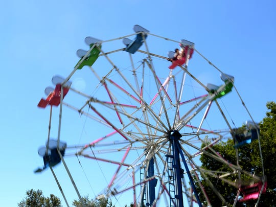 A Ferris wheel spins at Bite & Brew of Salem at Riverfront Park on Saturday, July 22, 2017.