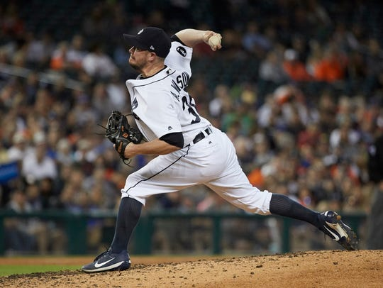Tigers pitcher Alex Wilson (30) pitches in the eighth