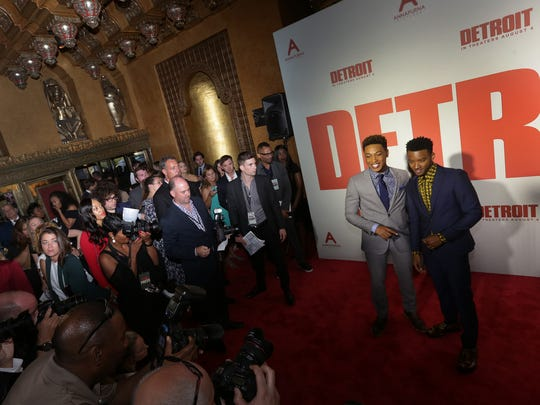 Algee Smith, right and Jacob Latimore pose for photographers on the red carpet for the world premiere of 'Detroit' directed by Kathryn Bigelow at the Fox Theatre in Detroit on Tuesday, July 25, 2017.