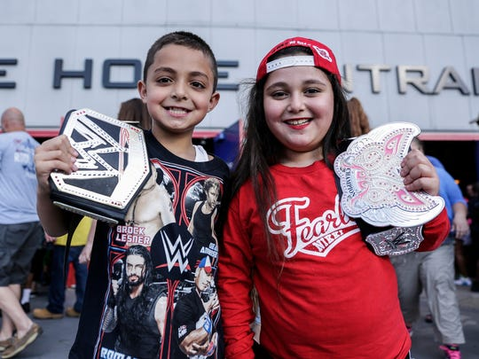 Wrestling fans Malek Ahmad, 8, of Dearborn, left, and Malak Alqusairi, 9, also of Dearborn pose for a photo with their belts before attending WWE's SummerSlam at Joe Louis Arena, Saturday, July 29, 2017, in Detroit.