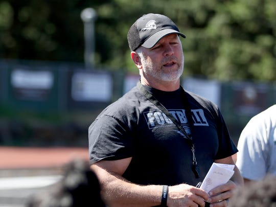Shawn Stanley, the head coach for West Salem High School football, talks to his team following practice before the season starts in West Salem on Friday, Aug. 18, 2017.