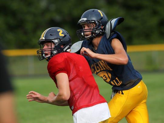Regina's Michael Conlon, left, and Alec Wick run drills during practice on Monday, Aug. 21, 2017.
