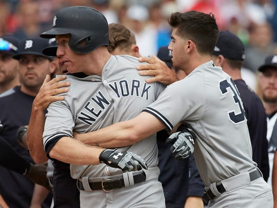 Yankees second baseman Tyler Wade (39) restrains third baseman Todd Frazier (29) after he was hit by a pitch by Tigers relief pitcher Alex Wilson (not pictured) in the eighth inning of the Tigers' 10-6 win on Thursday, Aug. 24, 2017, at Comerica Park.