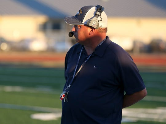 Stayton head coach Randy Nyquist watches the first