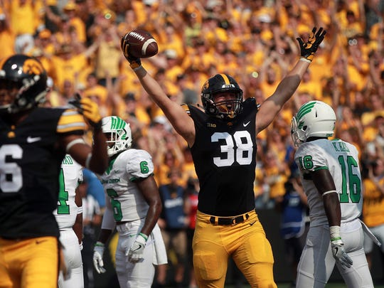 Iowa tight end T.J. Hockenson celebrates his touchdown during the Hawkeyes' game against North Texas at Kinnick Stadium on Saturday, Sept. 16, 2017.