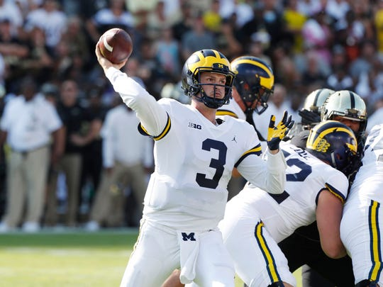Michigan quarterback Wilton Speight throws a pass in the first quarter against Purdue during a Sept. 23, 2017 game at Ross-Ade Stadium in West Lafayette, Ind.