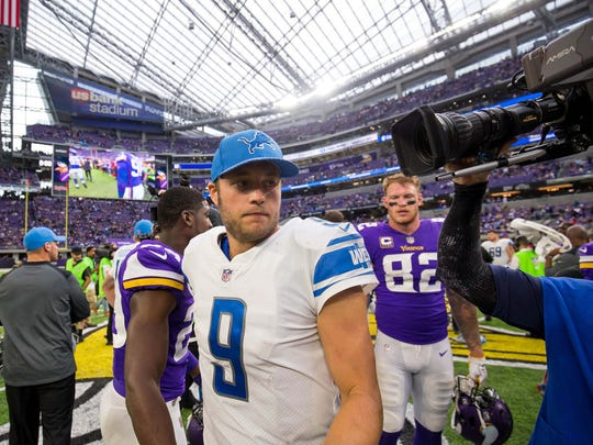 Matthew Stafford shakes hands after the Lions' 14-7 win over the Vikings at U.S. Bank Stadium on Oct. 1, 2017 in Minneapolis.