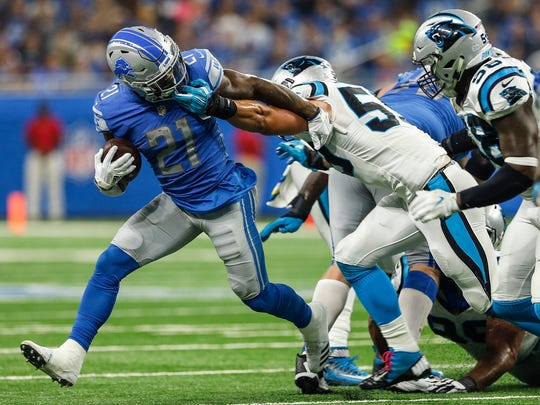 Ameer Abdullah is face-masked by Thomas Davis in the first half of the Lions' 27-24 loss to the Carolina Panthers at Ford Field on Sunday, Oct. 8, 2017.
