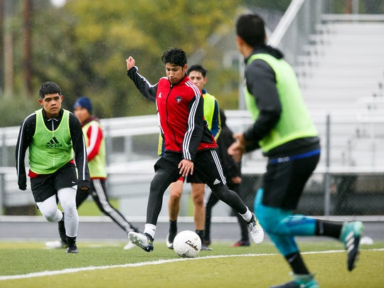 North Salem soccer player Alan Cruz, center, and teammates scrimmage during a practice on Thursday, Oct. 12, 2017.