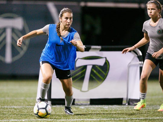 West Salem's Lexi Tejeda, left, at a Thorns Academy soccer practice Tuesday, Oct. 24, 2017, at Providence Park in Portland, Ore. Tejeda plays for the Thorns Academy U17 team.