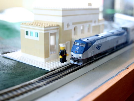 A model train moves around the tracks in a new exhibit,