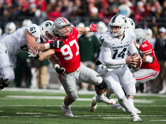 Nov 11, 2017; Columbus, OH, USA; Ohio State defensive lineman Nick Bosa is blocked by Michigan State offensive tackle Cole Chewins as quarterback Brian Lewerke looks for an open receiver in the first half at Ohio Stadium.