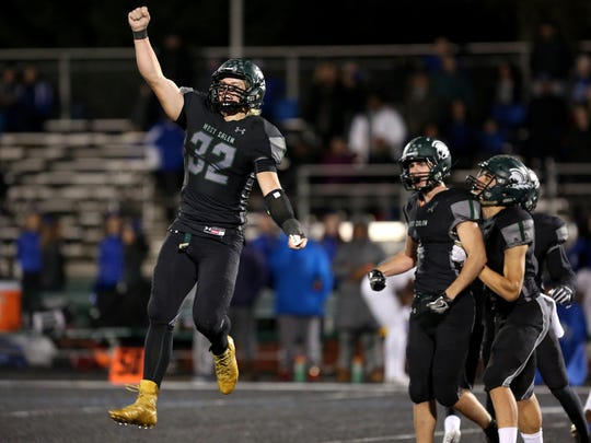 West Salem's Ioane Titialii (32) celebrates a turnover on downs in the Grant vs. West Salem football game in the second round of the OSAA Class 6A playoffs at West Salem High School on Friday, Nov. 10, 2017. West Salem won the game 33-24.