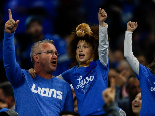 Fans cheer for the Detroit Lions in the second half