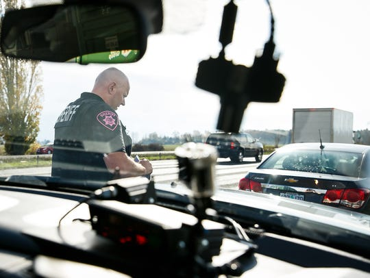 Marion County Sheriff's Office Sgt. Todd Moquin approaches